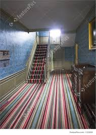 A very old Striped Carpet in a Colonial Home