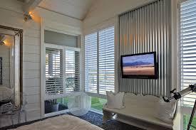 corrugated metal on interior walls bedroom rustic with corrugated metal siding wood trim window treatments