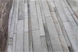 close up of a gray and white patchwork cowhide rug