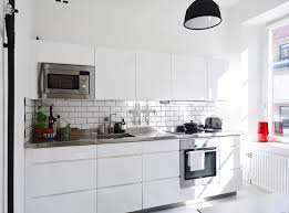 black pendant light subway tiles stainless steel countertop dazzling white tile kitchen backsplash 6