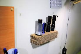 picture of diy floating cardboard shelf with storage