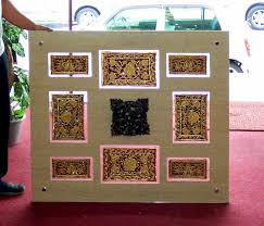 the solution clear perspex framing by using 2 pieces of clear acrylic thai silk plus the stained wooden carving attached to the centre for 3