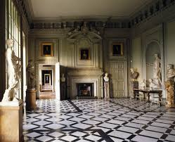 stately home interiors. the marble hall, petworth house, west sussex, england. one of great stately homes england, house has been owned by wyndam family for home interiors l