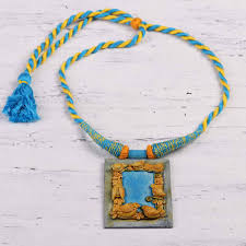 handcrafted ceramic blue and gold bird frame necklace bird