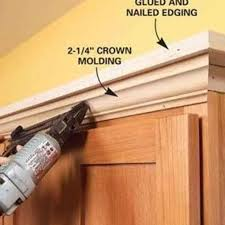 kitchen moldings: add molding shelving to the top of your kitchen cabinets http