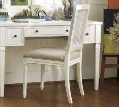 fluted legs add a stylish touch to the pottery barn kayla desk white wood desk chair