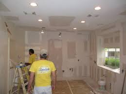 pot lights in finished ceiling recessed lighting installation tips modern wall sconces and bed