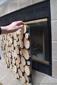 diy tutorial on how to make a faux stacked log fireplace screen check out