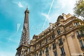The eiffel tower—or as the french call it, la tour eiffel—is one of the world's most recognizable landmarks. City Street In Paris France Eiffel Tower And Old French Building In Summer Condensation Trail Of Jet Plane On Blue Sky Buy This Stock Photo And Explore Similar Images At Adobe