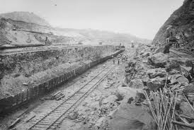gallery years of the canal in photos newshour steam shovels load rocks blasted away onto twin tracks that remove the earth from the