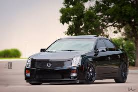 Cadillac CTS-V Generation One with custom 6 lug 19 inch Forgestar ...