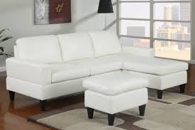 simple small living room decoration ideas with white leather sectional sleeper sofa with chaise plus leather ottoman table with wooden legs on carpet tiles