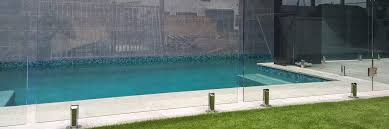 frameless glass pool fencing in a modern setting