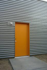 corrugated metal siding corrugated metal siding with entry door and exterior wall lighting for exterior design