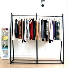 clothes shelf wrought iron clothing rack channel pendant male and shelves nifty with for nick reclaimed clothing racks