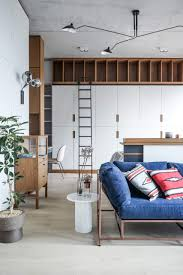 studio apartment furniture. Stephen Kenn Sofa, Charlotte Perriand Chest, And Hanging Lights Inside A Hong Kong Studio Apartment Furniture