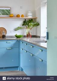 Contemporary Kitchen With Limestone And Beech Work Surfaces With Two
