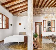 ... home in Mallorca through exposed #bricks, chipped cement, and exposed # beams: http://bit.ly/2CciOnF  Jos Hevia  #renovationpic.twitter.com/YFETvCXg9T