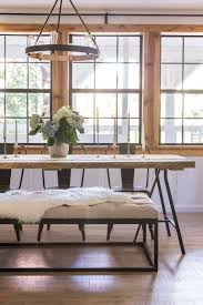 gorgeous wood and metal dining table with metal chairs and bench farm table hydrangea pine window