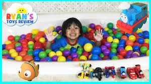 giant ball pits surprise toys challenge in bathtub disney cars toys batman superman thomas friends