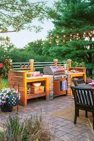 weber gas grills surrounded by diy cedar storage units is a quite popular way to go