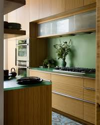 view in gallery glass cabinets set in a largely bamboo dominated kitchen