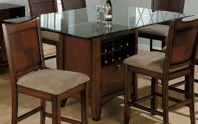 dining room square glass top table with brown wooden base combined with brown wooden chairs