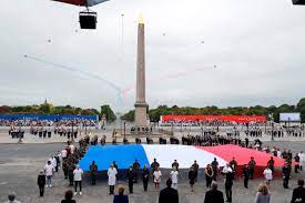 French President Presides Over Scaled ...