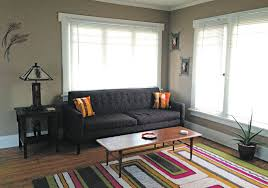 the living room has a modestly d tan 1963 lane acclaim walnut wood coffee table with