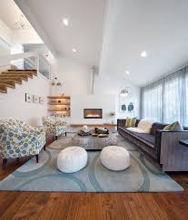 Cozy living room with white slanted ceiling, matching the tone of the rest  of the