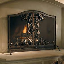 add character to your hearth with the toscana fireplace screen that features an intricate scrolling design and woven heavy gauge mesh that provides
