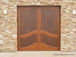 full custom stain grade wood garage door in hemlock with meranti plywood face 8 x8