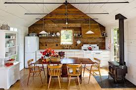 reclaimed wood accent wall and hood for the small stylish kitchen design jessica