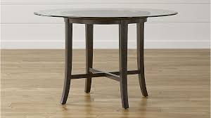 glass top round dining table in halo ebony tables with crate and barrel designs 0