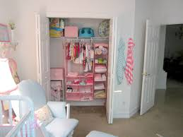 hanging door closet organizer. Interior, Baby Room In White Theme Mixed With Closet Organizer And Small Single Cloth Hanging Door