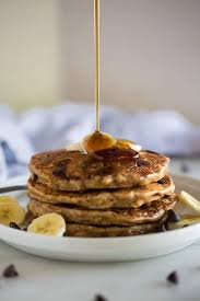 a line of syrup drizzled onto a stack of whole wheat banana bread pancakes