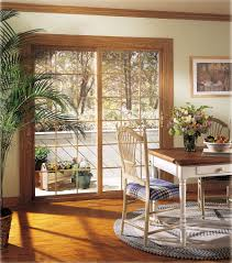 alside patio doors are available in white beige and three interior woodgrain finishes