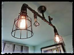 incredible ceiling mounted light fixture created using components iron pipe gauges valves