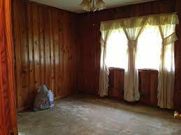 how to decorate around dark wood paneling