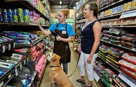 petco store interior. Brilliant Interior In A Store Aisle Young Female Petco Guest Advisor Helps Customer  Select The Throughout Store Interior C