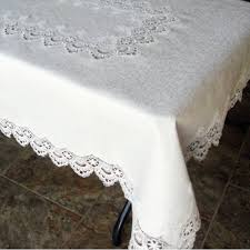 white peacock tail lace on white table cloth