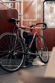 Download the perfect cycling pictures. Hd Wallpaper Black And Red Road Bike In Train Shoe Phone Hand Commute Wallpaper Flare