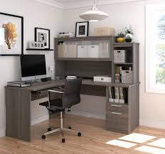 contemporary office decor. Bestar L Shaped Grey Wood Desk With Frosted Glass Door And Black Swivel Office Chair For Contemporary Decor