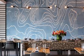 the far wall of the private dining room at alcove is decorated with a bright blue