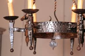 early 20th century french wrought iron six light chandelier with fleur de lys