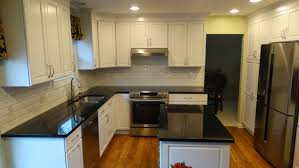 home design beveled subway tile backsplash white subwaytile accented with black granite countertops kitchenremodel remodel remodeling5