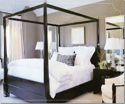 Suzie: chic black & taupe bedroom Love the black wood canopy bed ...
