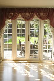 white pattern fabric curtains with brown valance for sliding glass door with white wood frame