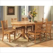 east west furniture 9 piece dining room table set double pedestal oval and a leaf and 8 dining room chairs as shown