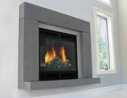 gas fireplace with a concrete fireplace surround and floating hearth concrete fireplace surrounds trueform